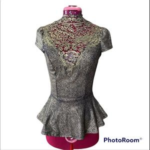 XS Lace peplum tee from Seductions by Sirens.